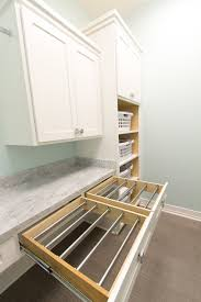 build in laundry racks that slide back into a drawer when you don