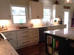 kitchen and bath showroom island homecrest cabinets arbor maple ivory perimeter and java island