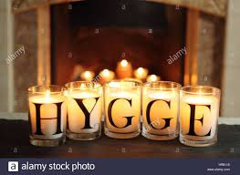 fireside candles in an english living room in winter depict u0027hygge