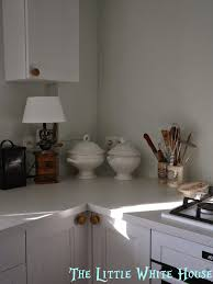 the little white house on the seaside back splash to the kitchen