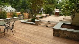 multi level wood deck with stone walls land art