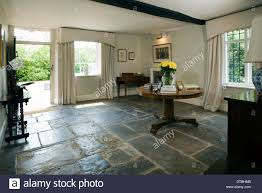 large traditional entrance hall with stone flag floor front door