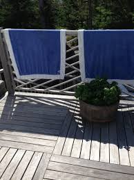 decorating with sheets beach towels a summer staple the two blue