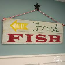 simple diy reclaimed wood sign for the entry hall the happy housie