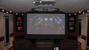 hidden tensioned electric projection screen in living room home