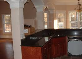 light oak cabinets with black granite countertops kitchen