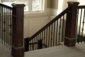 the graceful curved staircase with an octagonal newel post and
