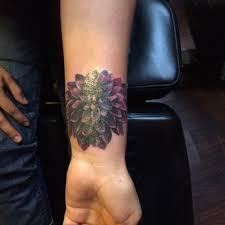 amazing dahlia flower tattoo on wrist