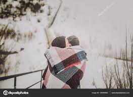 cuddling lovers wrapped in blanket u2014 stock photo