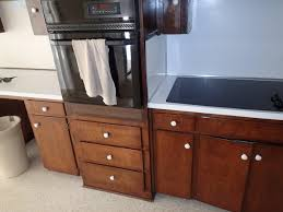 modern kitchen with brown cabinets and aron cabinet depot