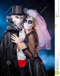 man and woman wearing as vampire and witch halloween royalty free