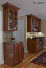 Kitchen Backsplash Cherry Cabinets Kitchen Remodel By Renovisions Decorative Tan And Black Tile