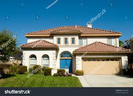 spanish style contemporary house green grass stock photo 18916642