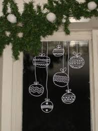 Christmas Ball Window Decorations by Best 25 Christmas Window Display Ideas On Pinterest Christmas