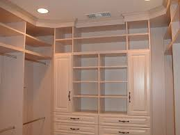 classic white pine wood corner shelving unit with cabinet doors of
