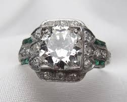 art deco diamond and baguette cut emerald engagement ring