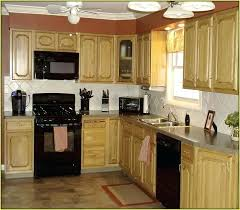 kitchen colors with black appliances what color to paint kitchen cabinets with black appliances faced