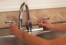 how to change out a kitchen faucet installing a kitchen faucet and side sprayer at the home depot