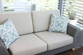 beige glider slipcover on dark pergo flooring with ikea side table