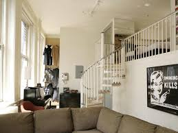 black fireplace mantel wing chair elegant beige upholstered sofa