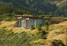 homes built into hillside green roofed ridge house is tucked into the hillside in big