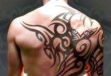 tribal om tattoo on biceps tattoos book