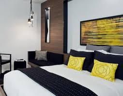 bedroom white couple bedroom with white cabinet and monochromatic couple bedroom with black and white tone popped up with yellow pillows and painting for
