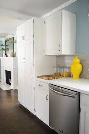 gray kitchen cabinets with white crown molding how to add crown molding to the top of your cabinets