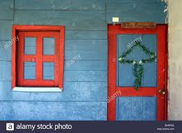 simple tinsel christmas tree decoration on door of rustic wooden
