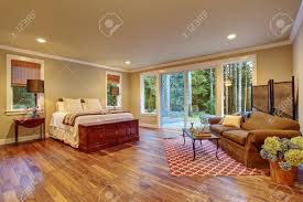 large master bedroom with hardwood floor and sliding glass door large master bedroom with hardwood floor and sliding glass door to backyard stock photo