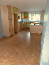 cork flooring installed in kitchen with custom plywood cabinets