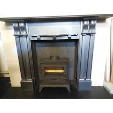 quality defra stove with output of 8 4kw and original slate surround