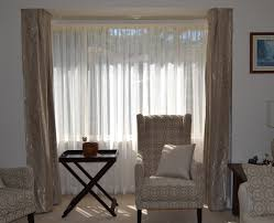 bay window with double track main u0026 sheer curtains lounge
