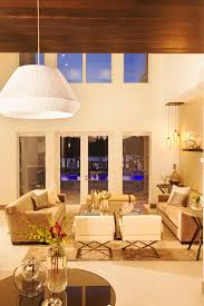 photos hgtv contemporary living room with high ceilings warm gold