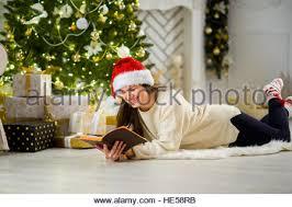 cute the brunette in santa u0027s cap beautifully decorated stock