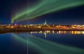 northern lights trip iceland imagine peace tower in the background of reykjavík iceland my