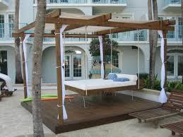 very popular teak outdoor hanging beds under pergola roof on