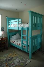 great bunks and i love the bedding folded at the foot of the bed