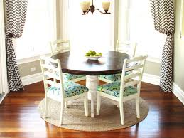excellent bay window with round sisal rug for elegant breakfast