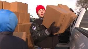 open door mission volunteers deliver thanksgiving turkeys to those