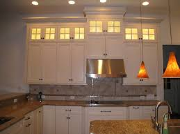 Crown Molding On Top Of Kitchen Cabinets Stacked Cabinets Staggered For Visual Interest Glass Uppers To