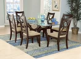 dining room set with white leather chairs and glass table top