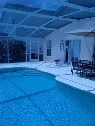 swimming pool swimming pool light bulb with black iron patio