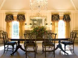 dining room luxurious chandelier above long table and classic