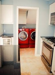 love the wall color with red washer and dryer beautiful words to
