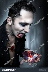 halloween vampire eat heart dark portrait stock photo 84183379