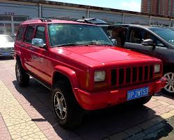 red jeep cherokee a very red beijing jeep cherokee in china carnewschina com