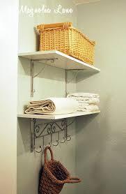 laundry room makeover with diy laundry room folding shelf 11