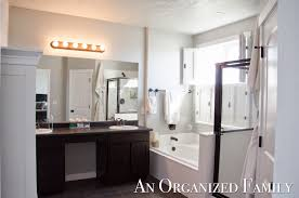 an organized family project master bathroom update with shutters