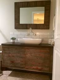 bathroom reclaimed wood vanity with white sink and faucet plus